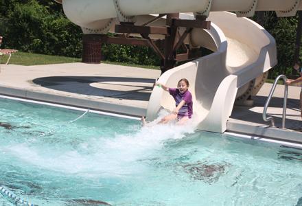 girl sliding down the slide