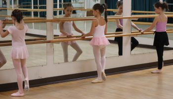 Three young girls practicing ballet
