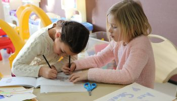 children drawing and coloring together