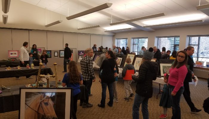 guests looking at artwork at the art show